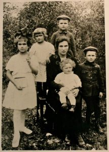 My grandmother, Ides Bronfeld, surrounded by children (standing from left) Hinda Ethel, Sura (Sally), Al, Herzek (Benny), and Marge (in her lap), taken in Zawichost, Poland, circa 1926.